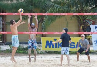 Tyce Mister goes for a tip against Jazz Roskow, while Russ Quinn and Jesse Palacios stand by for the next play during their elimination game in the For the Love of Volleyball Tournament last Saturday at the Hyatt Regency Saipan sand court. (Roselyn B. Monroyo)